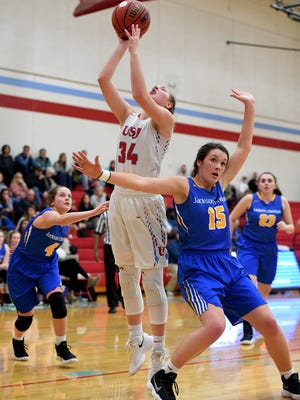 USJ's Kaleigh Kwasigroh goes up for a shot over Jackson Christian's Sophie Dunavant during their game, Friday, Feb. 2. USJ defeated JC, 66-31.