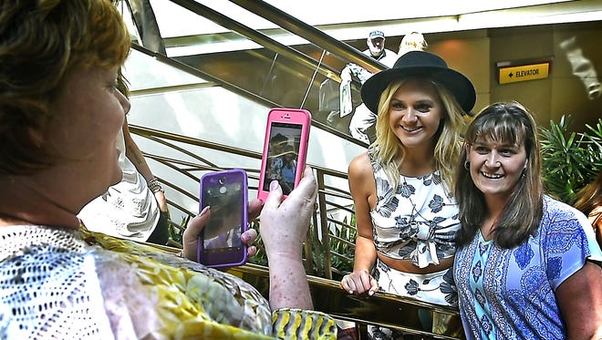 Kelsea Ballerini, who has already won New Female Artist of the Year and is still up for ACM Awards Female Vocalist stops for photos with fans on Thursday March 31, 2016, in Las Vegas as she strolls through the MGM Grand where the awards show will be held on Sunday.