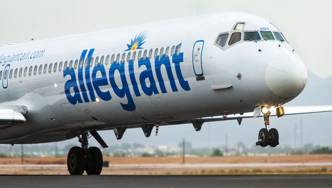 An Allegiant Airlines flight takes off at Williams Gateway Airport in Mesa July 17, 2014.