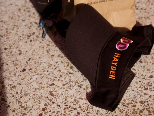 Employees at the Dunkin' Donuts location on Livingston and Immokalee Road, run by franchise owner Michael Koroghlian, had an embroidered visor made for Hayden Dougherty, 15, a frequent customer who is diagnosed with down syndrome Tuesday, May 23, 2017 in Naples.