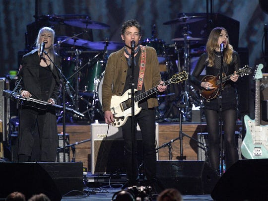 Rebecca Lovell (left) and Megan Lovell of Larkin Poe flank The Wallflowers' Jakob Dylan onstage during MusiCares Person of the Year honoring Tom Petty at the Los Angeles Convention Center on February 10 in Los Angeles, California.