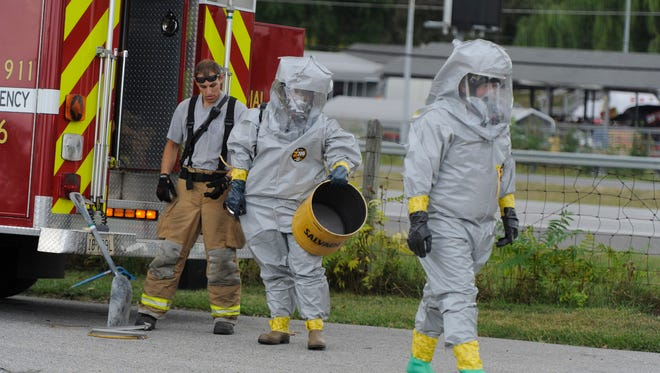 Waynesboro Fire and Rescue first responders wearing hazmat gear prepare to investigate the scene of a chlorine spill at Days Inn on Rosser Avenue in Waynesboro on Wednesday, Sept. 10, 2014.