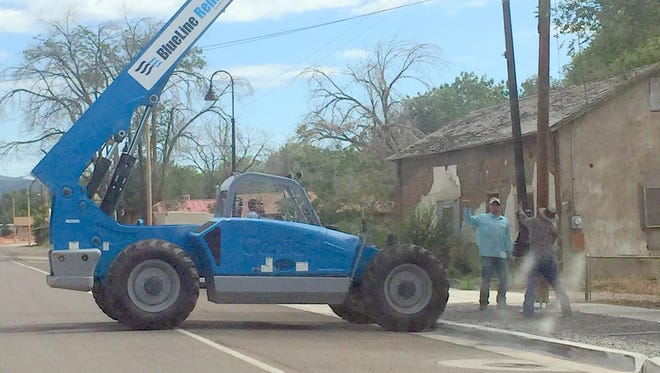 Crews worked on installing street lights in the Village of Santa Clara on Tuesday afternoon.