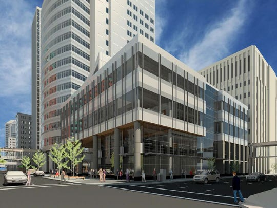 EMC Insurance Cos. plans to build a four-story office building at Eighth and Walnut streets. This rendering shows the building from the northwest.
