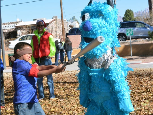 Jordan Cleveland, 8, from Fairacres Elementary takes a good swing at a pinata during one of the events held at this year's 10th Annual WinterFest held at Klein Park on Saturday morning.