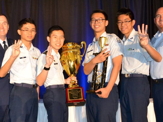 Cadets Alan Hang, Jackwin Hui, Albert Gu and Raymond Sun from Scripps Ranch High School, San Diego, celebrate their third win at the Junior ROTC Academic Bowl in Washington, D.C., June 25 with Col. Paul Lips (left), director of Air Force JROTC, and instructor Lt. Col. Michael Sheldon (right), Junior ROTC instructor at Scripps Ranch High School.