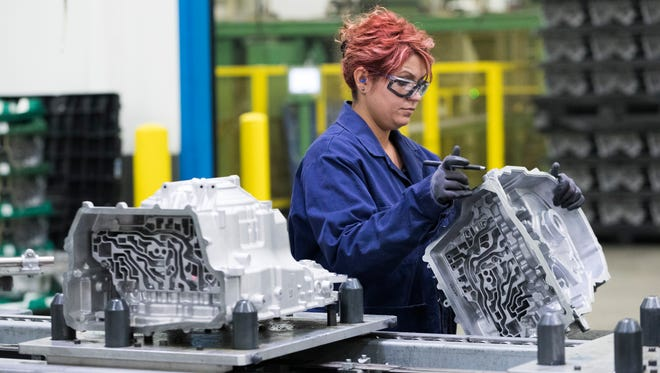 Dzenana Hadziosmanovic inspects a transmission case for a Ford pickup truck at Nemak, an automobile industry supplier that manufactures die-cast aluminum parts in Sheboygan. Like many companies, Nemak has had to work hard to find enough workers.