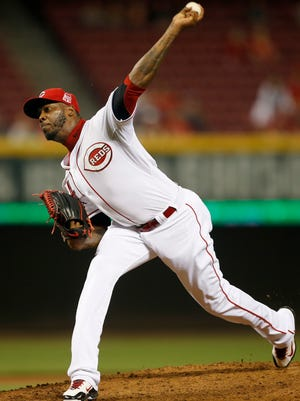 Reds relief pitcher Aroldis Chapman delivers to the plate in the ninth inning Monday.