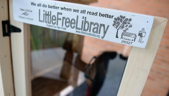 Leuchter third-grader Sheryln Bautista, 8, chooses books from the new Little Free Library at her school.