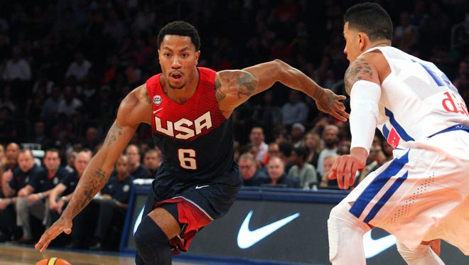 Aug 22, 2014: United States guard Derrick Rose (6) controls the ball in front of Puerto Rico guard David Huertas (12) during the second quarter of a game at Madison Square Garden.