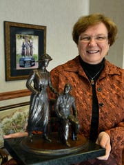 Attorney Wanda Sobieski in her Gay Street office with a model of the Burn Memorial.