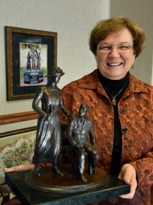 Attorney Wanda Sobieski in her Gay Street office with a model of the Burn Memorial she hopes to build and place in a downtown Knoxville location. Fundraising efforts are underway by the Suffrage Coalition for the Burn Memorial honoring state Rep. Harry Burn and his mother, Febb Ensminger Burn.