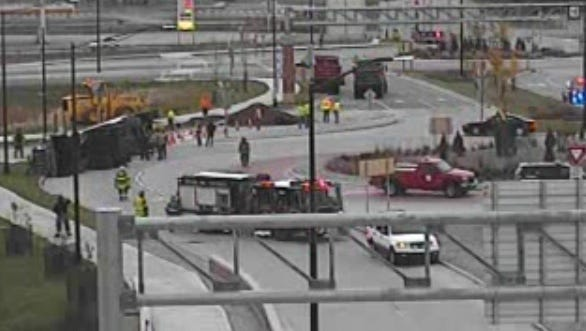A tanker truck rolled over in the roundabout at the top of the northbound U.S. 41 exit to Lineville Road in Howard on Friday.