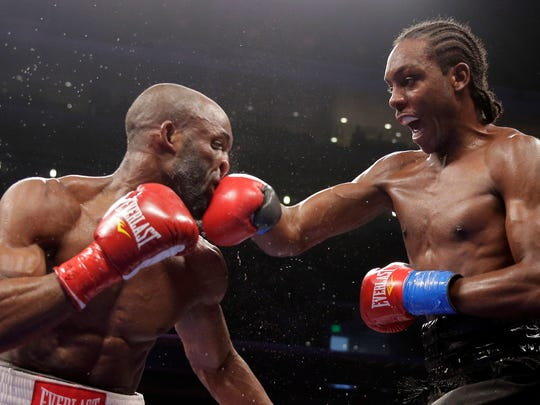 Amir Imam, right, hits Yordenis Ugas during their super lightweight boxing match in Los Angeles, Saturday, May 10, 2014. Imam won the bout. (AP Photo/Chris Carlson)