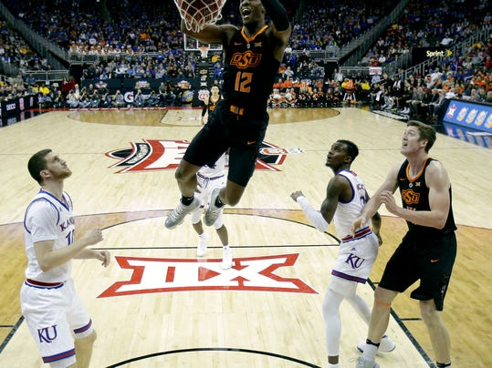 Oklahoma State's Cameron McGriff (12) puts up a shot during the first half of an NCAA college basketball game against Kansas in the Big 12 conference tournament Thursday, March 8, 2018, in Kansas City, Mo. (AP Photo/Charlie Riedel)