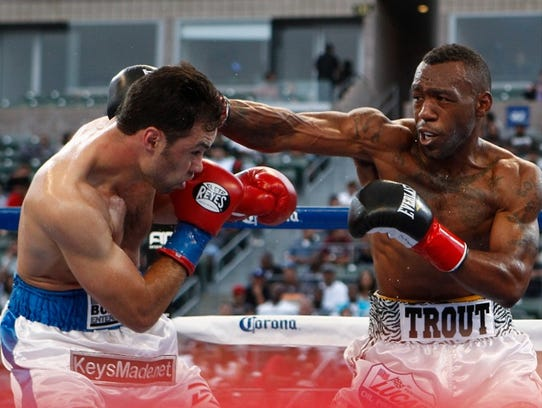 Austin Trout, right, faces off with Delvin Rodriguez