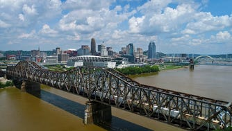 Drone footage over the Ohio River shows the Cincinnati, Ohio skyline from Covington, Kentucky, on Thursday, Aug. 3, 2017. (Carrie Cochran & Sam Greene / USA Today Network)