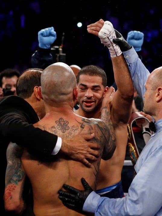 Sadam Ali, right, is congratulated by Miguel Cotto after defeating Cotto in a WBO junior middleweight title boxing match, early Sunday, Dec. 3, 2017, in New York. (AP Photo/Adam Hunger)
