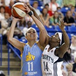 Chicago's Elena Delle Donne defends a shot by New York's Swin Cash in the first half of a WNBA preseason game at the  Carpenter Center last year.