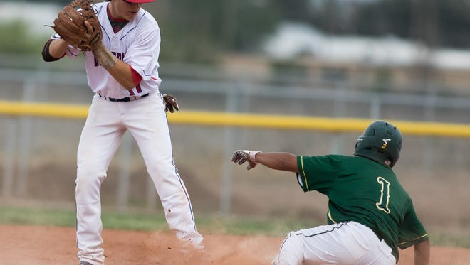 Las Cruces High's Ryan Olson gets the out at second as Mayfield's Michael Contreras comes in sliding during Friday's District 3-6A game at the Field of Dreams Baseball Complex.