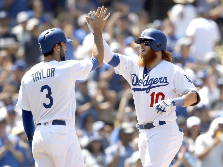 Justin Turner (right), Chris Taylor and the Los Angeles