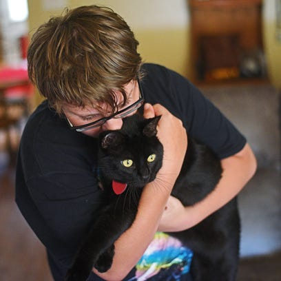 DJ Hilfers, 14, holds his cat Shadow Monday, May 15,