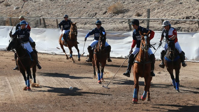 Players race after the ball during a practice polo session at Rancho Naranjo in Santa Teresa, N.M. The team, by the same name, is an interscholastic polo squad that will be competing in the U.S. Polo Association's Central Open Interscholastic Regional this weekend.