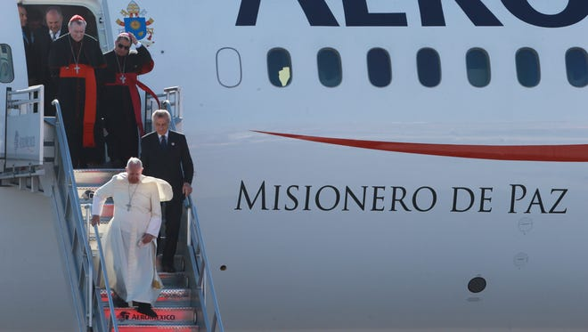 Pope Airport Juarez -Pope Francis disembarks from his plane after arriving at the airport Wednesday Feb. 17, 2016 in Ciudad Juarez, Chihuahua, Mexico. (Victor Calzada, El Paso Times)