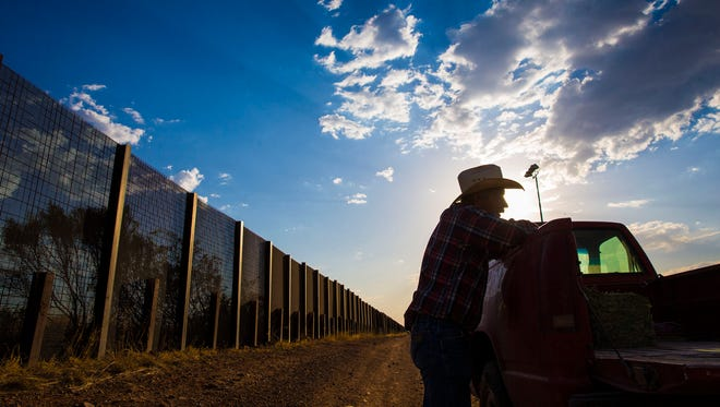 Naco, Arizona: Rancher John Ladd leans on his truck on his ranch, which borders with Mexico (behind him). He has been frustrated for years over the illegal border crossers and drug smugglers that cut through his ranch. The 16,000-acre calf/cow operation has been in the Ladd family for 121 years.