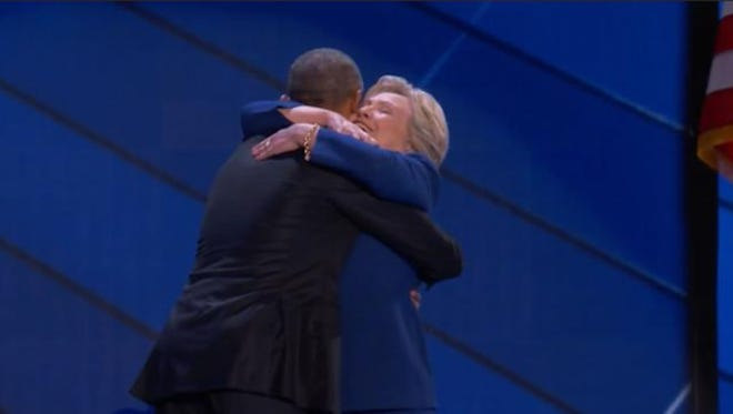 Former President Barack Obama hugs his former Secretary of State, Hillary Clinton, during the 2016 Democratic National Convention.