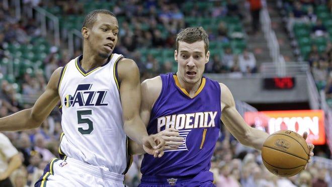 Suns guard Goran Dragic drives against Utah rookie Rodney Hood in a preseason game last month