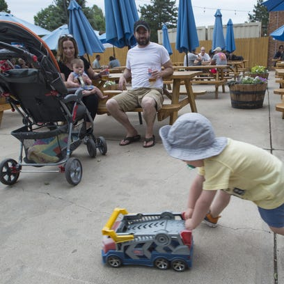 Raif Bernatow, 3, pushes a toy truck past his father