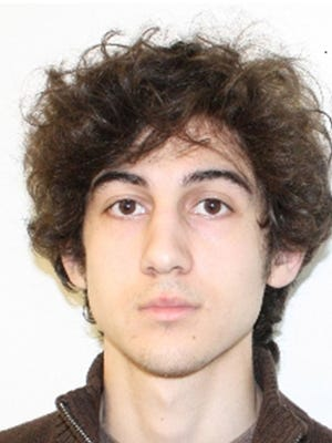 Boston Marathon bombing suspect Dzhokhar Tsarnaev is charged with carrying out the April 2013 attack that killed three people and injured more than 260.