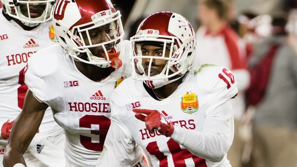 Hoosiers defensive back Rashard Fant (16) celebrates after intercepting the ball against the Utah Utes during the Foster Farms Bowl.