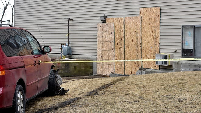 Boards cover the doorway of an apartment Monday that was hit with a vehicle at 410 14th St. S in St. Cloud.