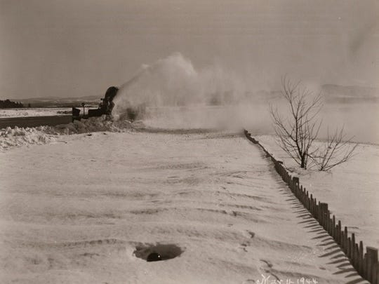 Rotary plow blows snow from a runway at the Burlington Municipal Airport in March 1944.