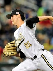 Vanderbilt pitcher John Kilichowski throws a pitch against TCU during the seventh inning in the College World Series at TD Ameritrade Park, Friday, June 19, 2015, in Omaha, Neb.