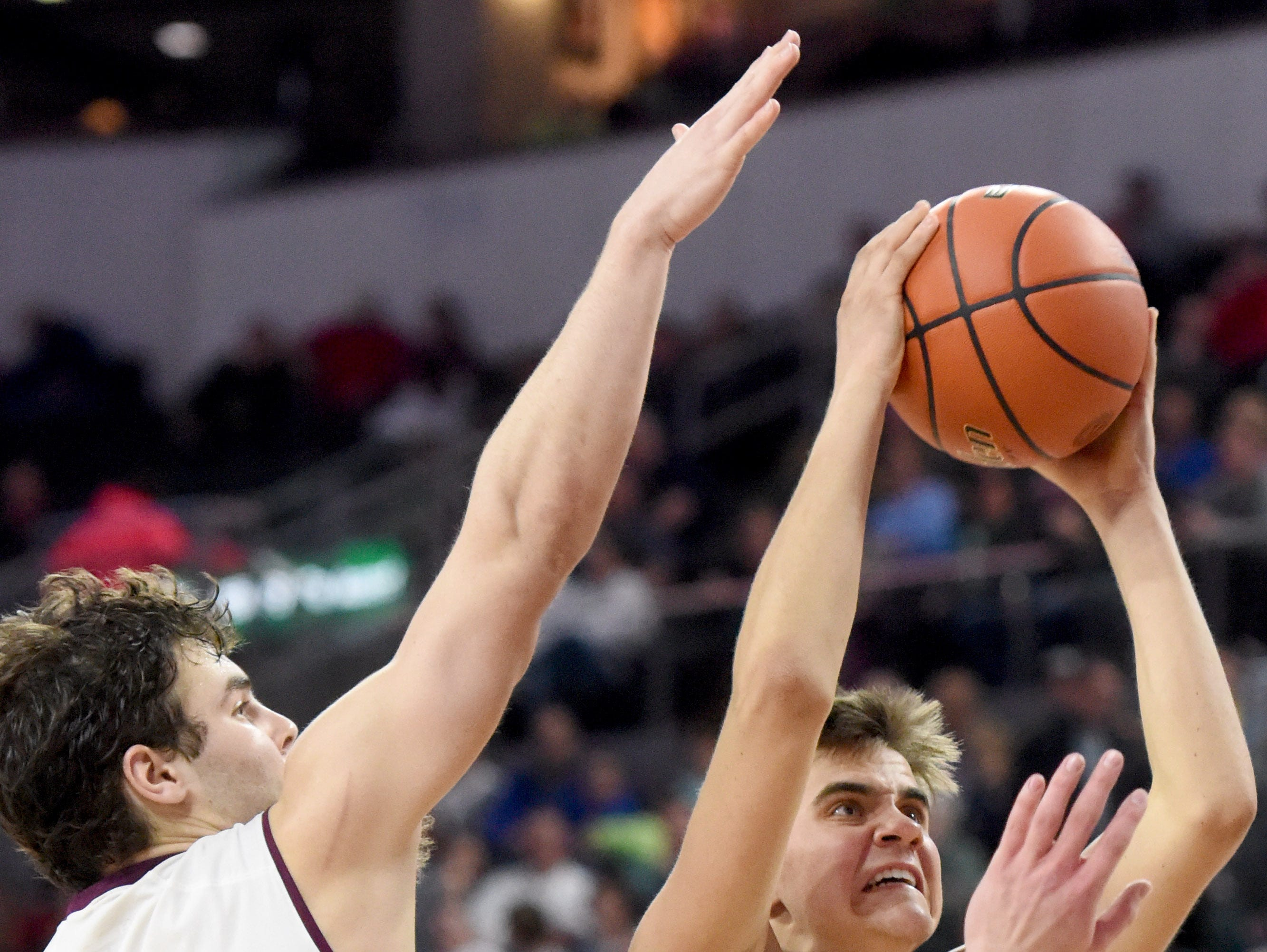 Sioux Falls Chrsitian's Koln Oppold goes up for a shot while Madison's Marcus VandenBosch defends during the 2017 SDHSAA Class A boy's basketball semifinals at the Denny Sanford Premier Center on Friday, March 17, 2017.