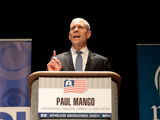 Paul Mango, a former health care systems consultant from suburban Pittsburgh and a first-time candidate, answers questions from the panel during a debate between Republican Gubernatorial candidates at Harrisburg Area Community College in Harrisburg, Pa., Thursday, March 1, 2018. (AP Photo/Chris Knight)
