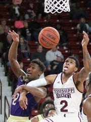 Mississippi State guard Lamar Peters (2) fights for a rebound with Alcorn State guard Jael Scott (2) during the first half of their NCAA college basketball game Monday, Nov. 26, 2018, in Starkville, Miss. (AP Photo/Jim Lytle)