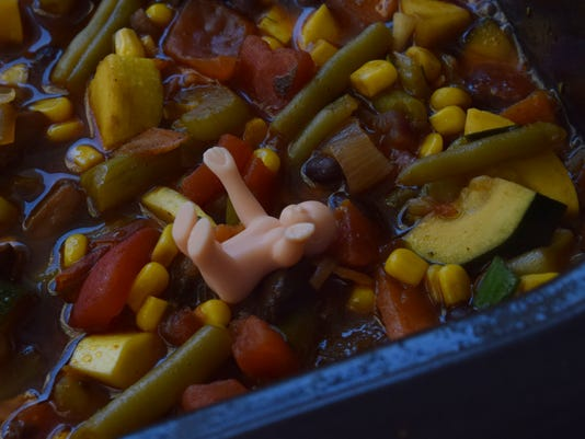 Lauren Karahalis came up with the idea for the Stone Soup Mardi Gras Party where everyone could bring ingredients for the soup and other foods to eat. A plastic baby was placed in the corner of the soup.