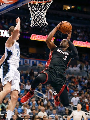Miami Heat guard Dwyane Wade (3) shoots over Orlando Magic guard Mario Hezonja (23) during the second quarter of a basketball game at Amway Center.