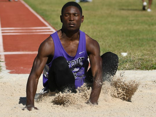 George Allen of Space Coast participates in the triple-jump during the Cape Coast Conference track meet Thursday.