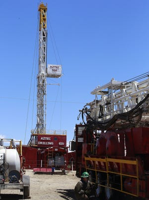 An idle workover rig sits in Aztec Drilling's rig yard. A recent report states there are four active rigs in the San Juan Basin, the highest number since November 2015.