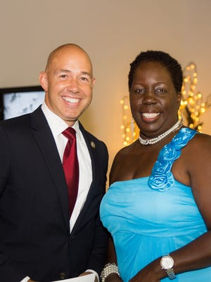 Rozanne Roxy Brown, founder and CEO of CareBag Inc., right, with Congressman Brian Mast at Carebag's inaugural gala on Oct. 7 at  Regal Event Hall in Port St. Lucie.