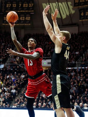 Louisville forward Ray Spalding takes a shot against Purdue center Isaac Haas during the second half at Mackey Arena.