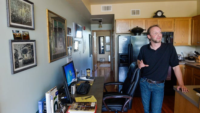 Jake Barber says he loves living in his 600-square-foot apartment in St. Joseph's Mill Stream lofts. He says not having to do home maintenance is nice, seeing others moving around town in the morning motivates him, and he enjoys walking out to the coffee shop or pizza parlor.