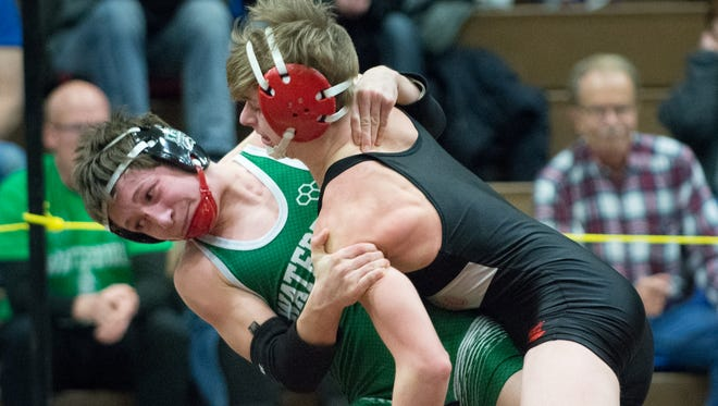 Parker Bevilacqua of Muskego (right) takes down  Joshua Cherba of Waterford in the 113-pound final.