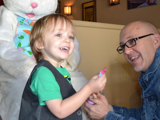 Keagan Sterling, 2, was also not too sure about his interaction with the Easter Bunny at Heritage On Main Street until he opened a plastic egg and found candy inside.