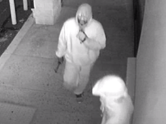 Surveillance footage shows two suspects in a series
